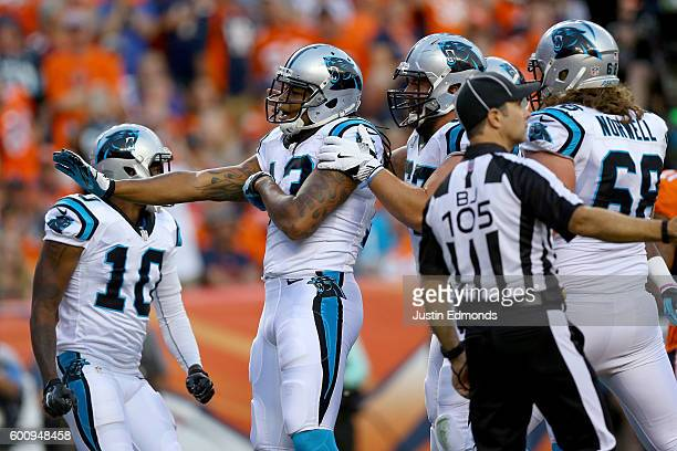Wide receiver Kelvin Benjamin of the Carolina Panthers celebrates after scoring on a 14yard touchdown reception in the first quarter against the...