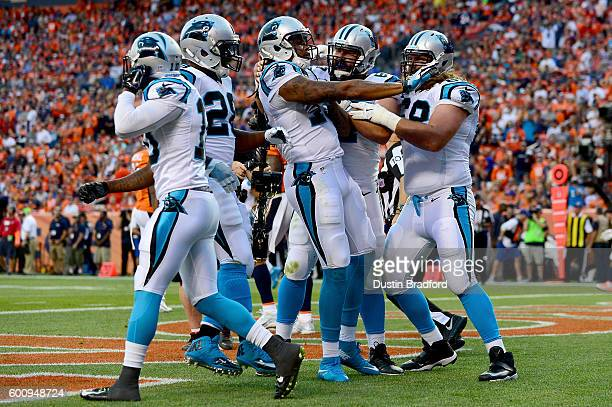 Wide receiver Kelvin Benjamin of the Carolina Panthers celebrates with teammates after scoring on a 14yard touchdown reception in the first quarter...