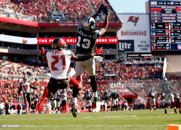 Wide receiver Kelvin Benjamin of the Carolina Panthers hauls in a 25yard pass from quarterback Cam Newton in front of strong safety Justin Evans of...