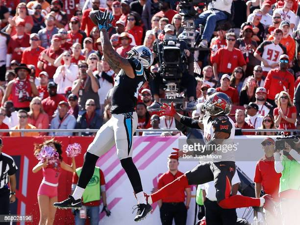 Wide Receiver Kelvin Benjamin of the Carolina Panthers makes a catch for a touchdown over Safety Justin Evans of the Tampa Bay Buccaneers at Raymond...