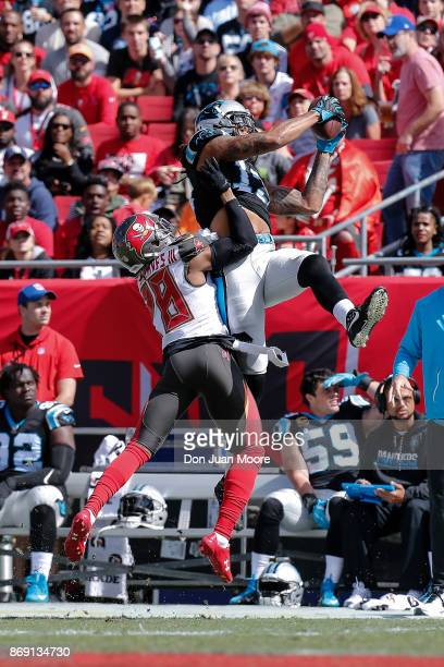 Wide Receiver Kelvin Benjamin of the Carolina Panthers makes a catch out of bounce against Cornerback Vernon Hargreaves of the Tampa Bay Buccaneers...