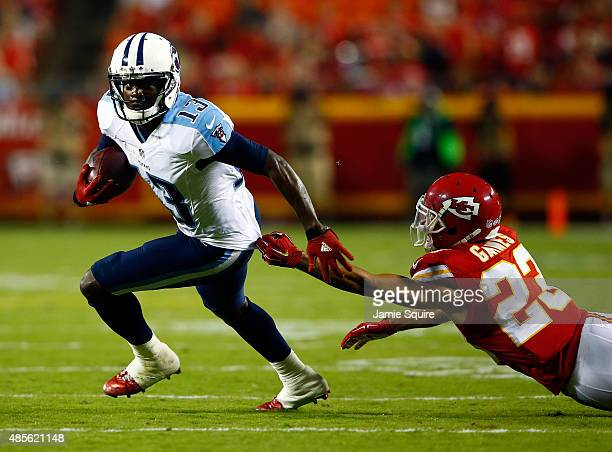 Wide receiver Kendall Wright of the Tennessee Titans evades cornerback Phillip Gaines of the Kansas City Chiefs after making a catch during the...