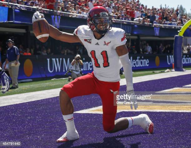 Wide receiver Kendrick Bourne of the Eastern Washington Eagles celebrates after scoring a touchdown in the first half against the Washington Huskies...