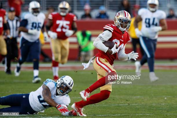 Wide receiver Kendrick Bourne of the San Francisco 49ers breaks a tackle from free safety Kevin Byard of the Tennessee Titans during the fourth...