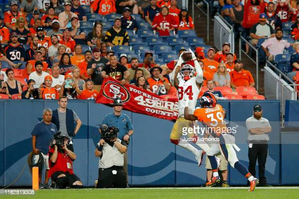 Wide receiver Kendrick Bourne of the San Francisco 49ers catches a touchdown pass against cornerback Trey Johnson of the Denver Broncos during the...