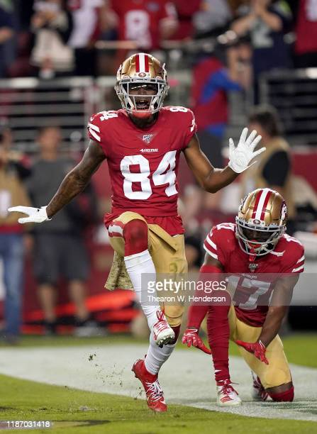 Wide receiver Kendrick Bourne of the San Francisco 49ers celebrates his touchdown with teammate Emmanuel Sanders in the first quarter over the...