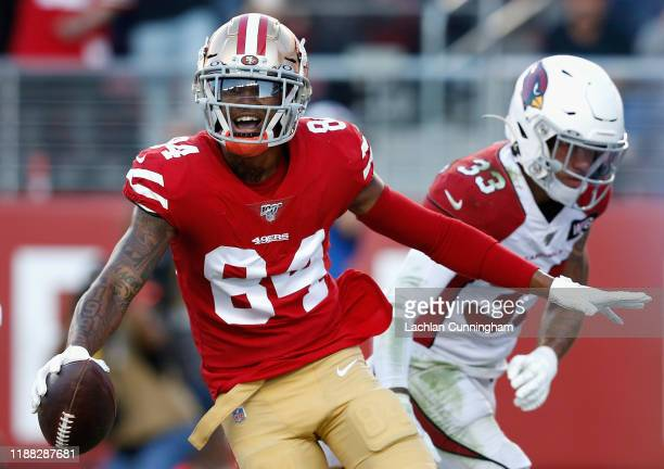 Wide receiver Kendrick Bourne of the San Francisco 49ers celebrates after scoring on a two yard touchdown reception ahead of cornerback Byron Murphy...