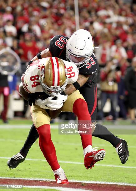 Wide receiver Kendrick Bourne of the San Francisco 49ers completes a pass for a touchdown in the second quarter over cornerback Byron Murphy of the...