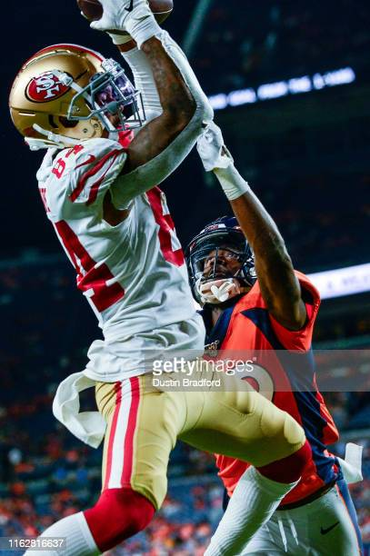 Wide receiver Kendrick Bourne of the San Francisco 49ers has a fourth quarter touchdown reception under coverage by cornerback Trey Johnson of the...
