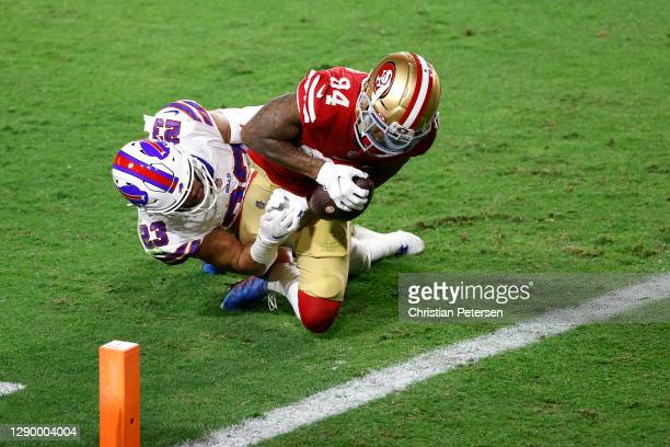 Wide receiver Kendrick Bourne of the San Francisco 49ers makes a reception ahead of defender strong safety Micah Hyde of the Buffalo Bills during the...
