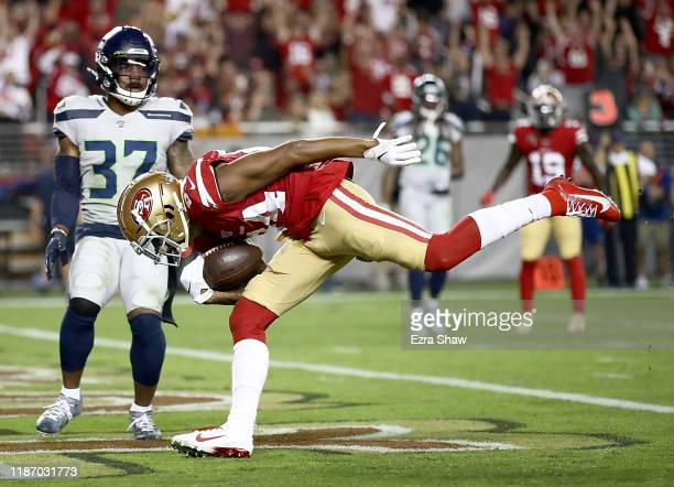 Wide receiver Kendrick Bourne of the San Francisco 49ers scores a touchdown the first quarter over the defense of defensive back Quandre Diggs of the...