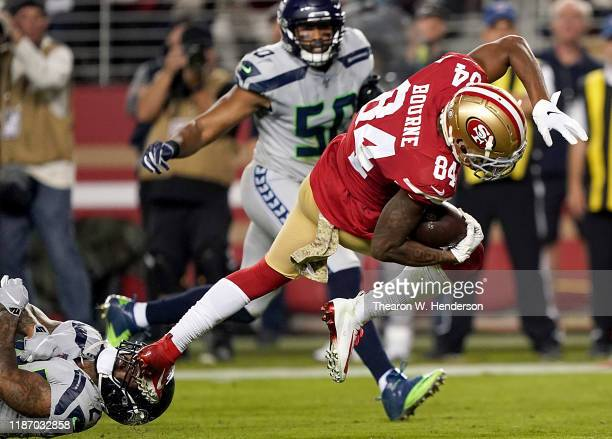Wide receiver Kendrick Bourne of the San Francisco 49ers scores a touchdown the first quarter over the defense of the Seattle Seahawks at Levi's...