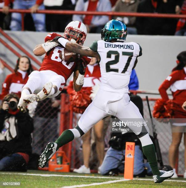 Wide receiver Kenny Bell of the Nebraska Cornhuskers catches a touchdown over safety Kurtis Drummond of the Michigan State Spartans during their game...