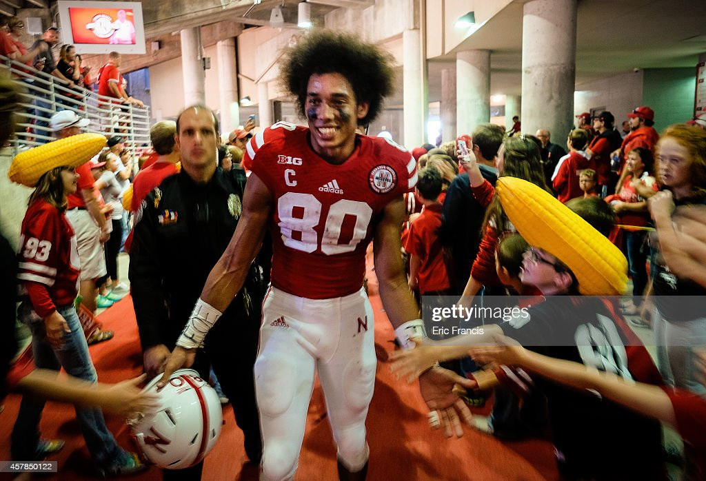Wide receiver Kenny Bell #80 of the Nebraska Cornhuskers is swarmed by fans after their game against the Rutgers Scarlet Knights at Memorial Stadium on October 25, 2014 in Lincoln, Nebraska. Nebraska defeated Rutgers 42-24.