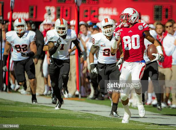 Wide receiver Kenny Bell of the Nebraska Cornhuskers runs to the end zone past linebacker Demetrius Allen and defensive back Cameron Gupton of the...