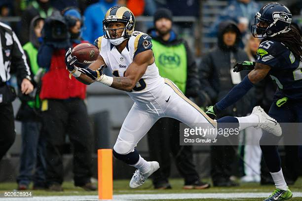 Wide receiver Kenny Britt of the St Louis Rams makes a catch for a touchdown in the second quarter against the Seattle Seahawks at CenturyLink Field...