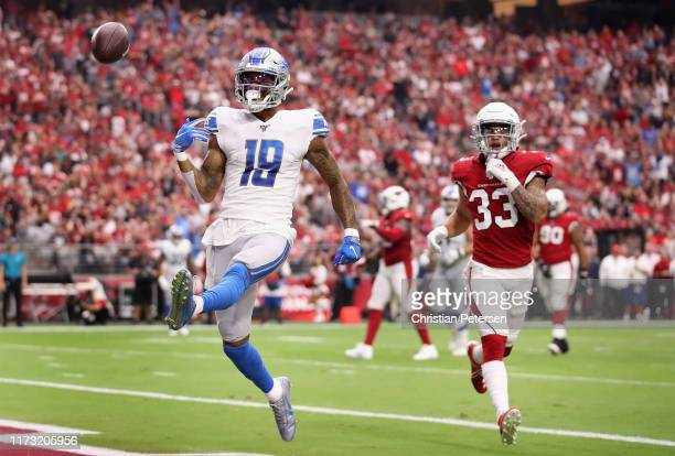 Wide receiver Kenny Golladay of the Detroit Lions celebrates after scoring a nine yard touchdown reception ahead of cornerback Byron Murphy of the...