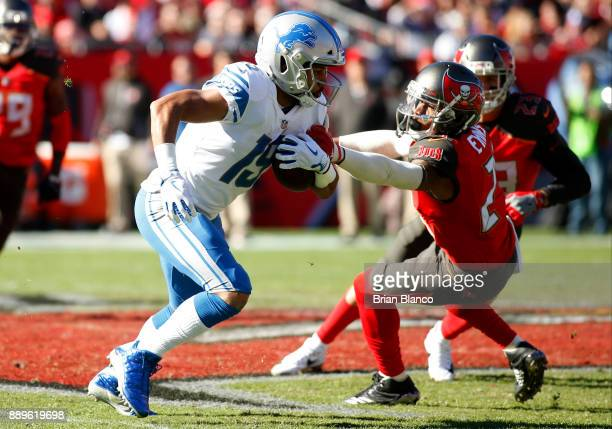 Wide receiver Kenny Golladay of the Detroit Lions evades strong safety Justin Evans of the Tampa Bay Buccaneers during a carry in the second quarter...