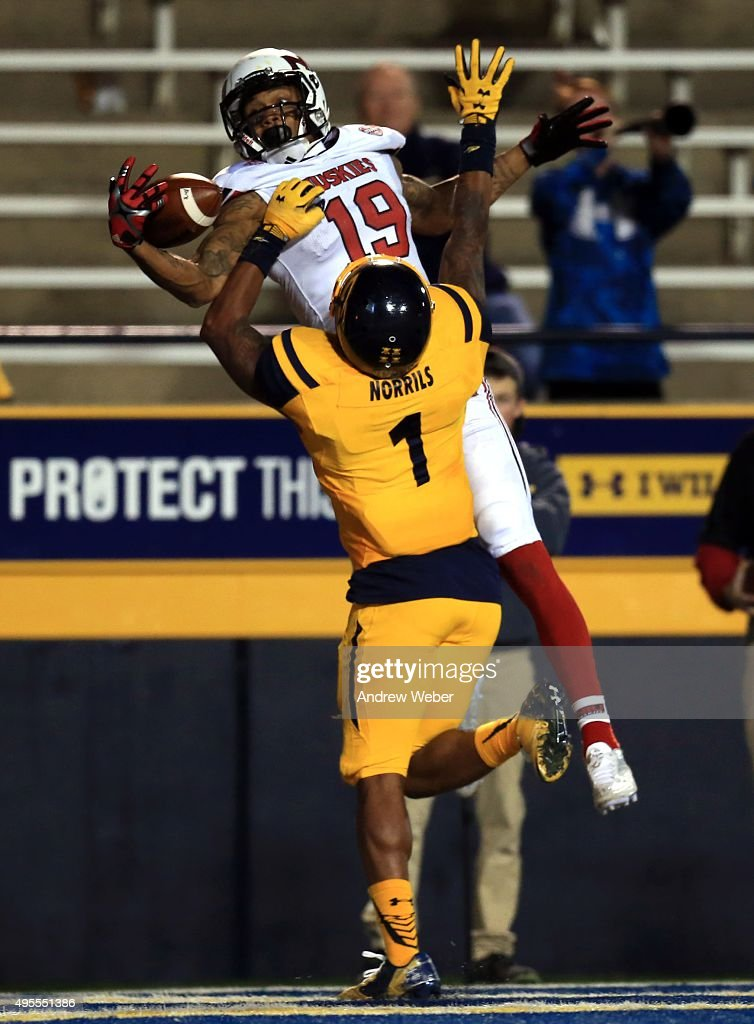 Wide receiver Kenny Golladay #19 of the Northern Illinois Huskies catches a pass for a touchdown while being defended by cornerback Cheatham Norrils #1 of the Toledo Rockets during the fourth quarter at Glass Bowl on November 3, 2015 in Toledo, Ohio.