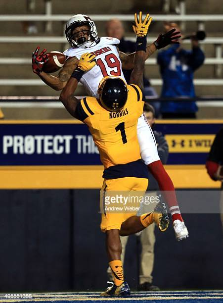 Wide receiver Kenny Golladay of the Northern Illinois Huskies catches a pass for a touchdown while being defended by cornerback Cheatham Norrils of...