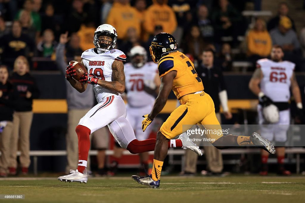 Wide receiver Kenny Golladay #19 of the Northern Illinois Huskies catches a pass while being defended by defensive back Connery Swift #3 of the Toledo Rockets during the fourth quarter at Glass Bowl on November 3, 2015 in Toledo, Ohio.