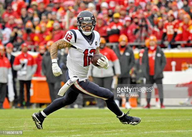 Wide receiver Kenny Stills of the Houston Texans runs up field in the first half during the AFC Divisional playoff game against the Kansas City...