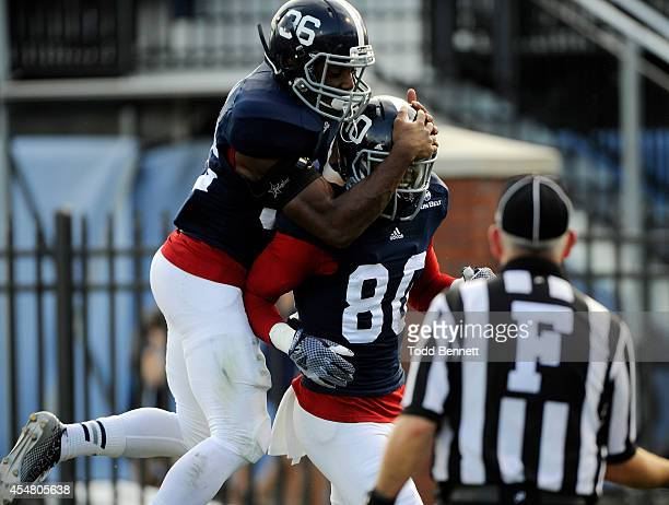Wide receiver Kentrellis Showers of the Georgia Southern Eagles is congratulated by wide receiver Kelton Elvine after scoring a touchdown during the...