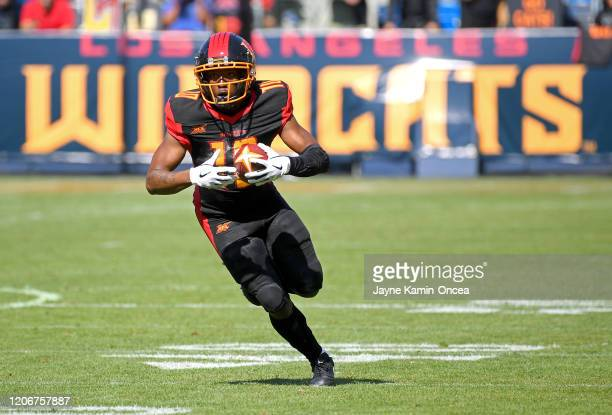 Wide receiver Kermit Whitfield of the Los Angeles Wildcats gains a first down in the first half of the game against the Dallas Renegades at Dignity...