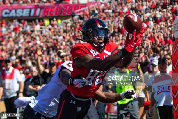 Wide receiver KeSean Carter of the Texas Tech Red Raiders catches a touchdown pass during the first half of the college football game between the...
