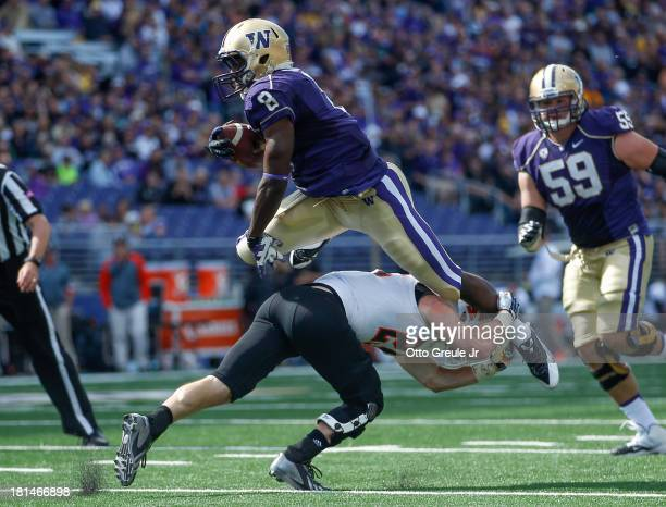 Wide receiver Kevin Smith of the Washington Huskies jumps over against Tanner Davis of the Idaho State Bengals on September 21, 2013 at Husky Stadium...