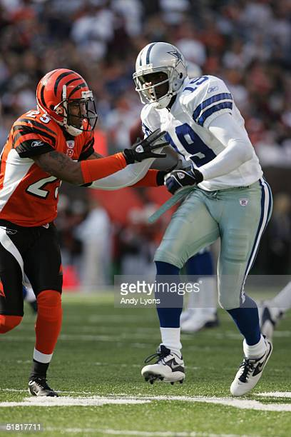 Wide receiver Keyshawn Johnson of the Dallas Cowboys is covered by cornerback Keiwan Ratliff of the Cincinnati Bengals during the game at Paul Brown...