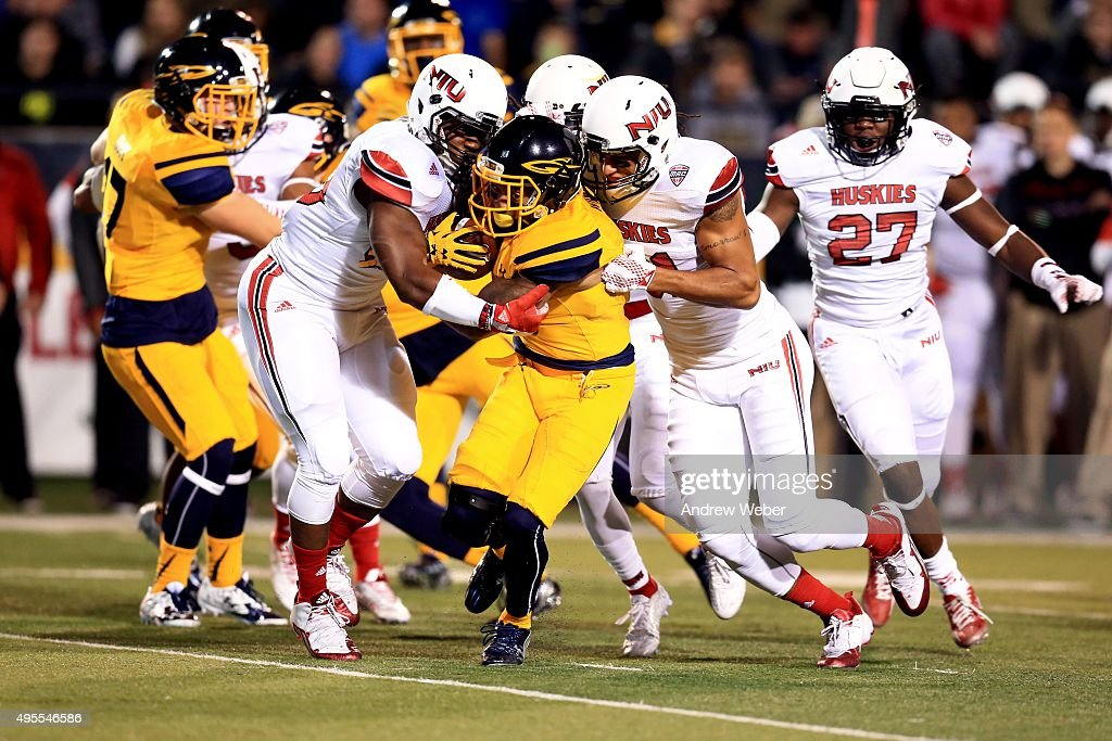 Wide receiver Kishon Wilcher #6 of the Toledo Rockets is tackled by the Northern Illinois Huskies defense against the XX at Glass Bowl on November 3, 2015 in Toledo, Ohio.