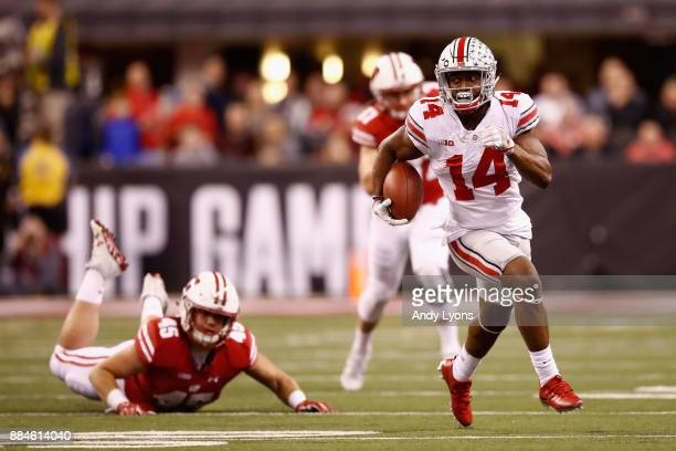 Wide receiver KJ Hill of the Ohio State Buckeyes runs the ball against fullback Alec Ingold of the Wisconsin Badgers in the second half during the...