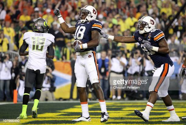 Wide receiver Kodi Burns of the Auburn Tigers reacts after scoring on a 35-yard touchdown reception in the second quarter against the Oregon Ducks...