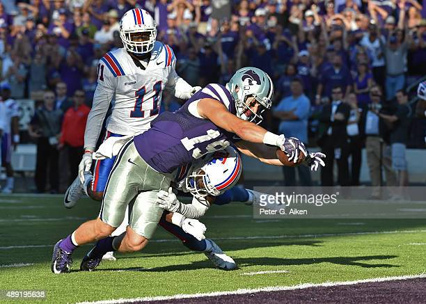 Wide receiver Kody Cook of the Kansas State Wildcats dives into the end zone after catching a 31yard touchdown pass against the Louisiana Tech...