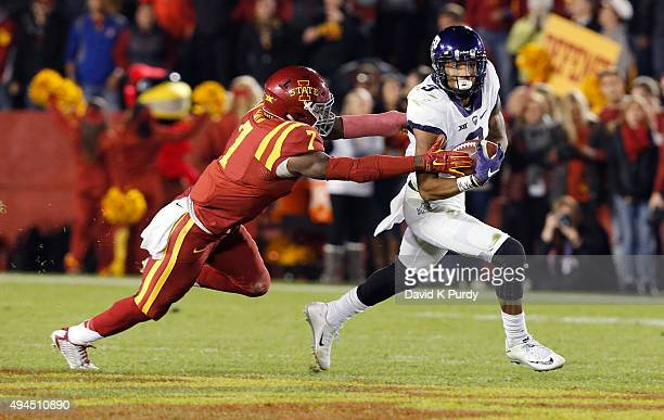 Wide receiver Kolby Listenbee of the TCU Horned Frogs defensive back Qujuan Floyd of the Iowa State Cyclones puts pressure on in the first half of...