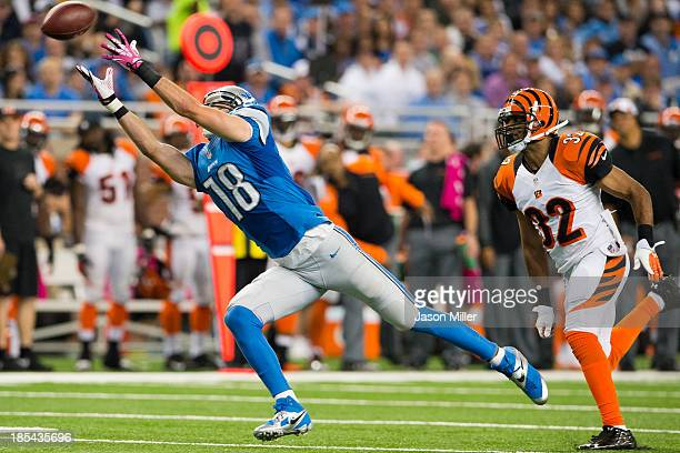 Wide receiver Kris Durham of the Detroit Lions catches a pass while under pressure from defensive back Chris Crocker of the Cincinnati Bengals during...
