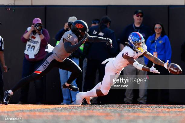 Wide receiver Kwamie II of the Kansas Jayhawks can't quite get his fingers on a pass to the end zone against cornerback JayVeon Cardwell of the...