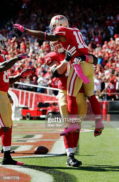 Wide receiver Kyle Williams of the San Francisco 49ers celebrates a touchdown in the arms of tackle Joe Staley against the Buffalo Bills in the...