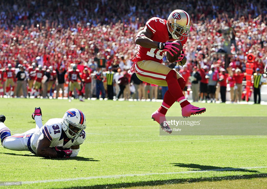 Wide receiver Kyle Williams #10 of the San Francisco 49ers leaps into the endzone to score a touchdown against free safety Jairus Byrd #31 of the Buffalo Bills in the second quarter on October 7, 2012 at Candlestick Park in San Francisco, California.