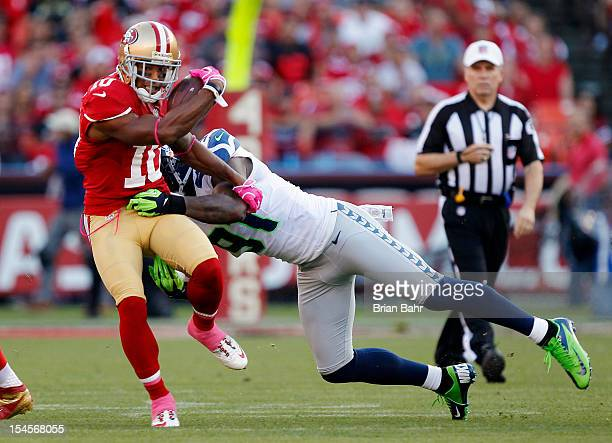 Wide receiver Kyle Williams of the San Francisco 49ers twists away from defensive end Chris Clemons of the Seattle Seahawks in the first quarter on...