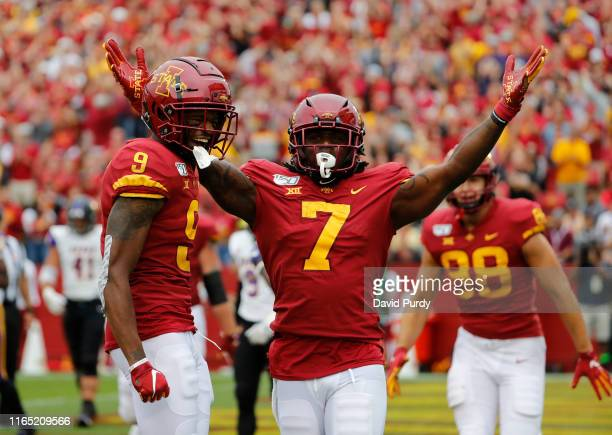 Wide receiver La'Michael Pettway of the Iowa State Cyclones celebrates after scoring a touchdown with teammate wide receiver Joseph Scates and tight...
