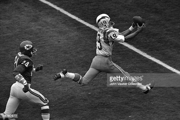 Wide receiver Lance Alworth of the San Diego Chargers catches a touchdown pass from quarterback John Hadl during the first quarter of a game on...