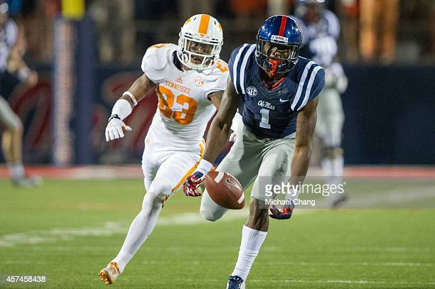 Wide receiver Laquon Treadwell of the Mississippi Rebels attempts to catch a pass in front of defensive back Cameron Sutton of the Tennessee...