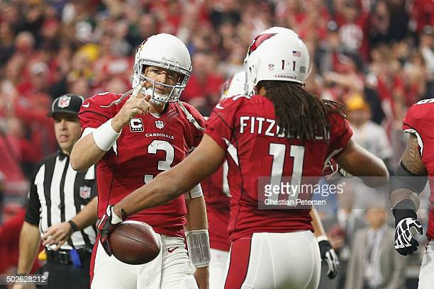Wide receiver Larry Fitzgerald and quarterback Carson Palmer of the Arizona Cardinals celebrate after Fitzgerald scored a 3 yard touchdown in the...
