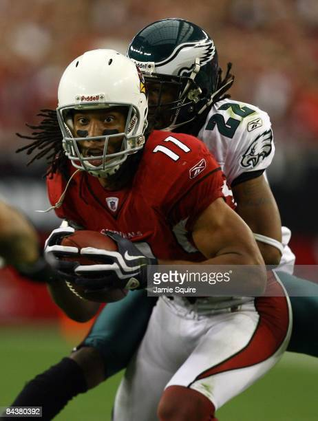 Wide receiver Larry Fitzgerald of the Arizona Cardinals attempts to break a tackle by cornerback Asante Samuel of the Philadelphia Eagles during the...
