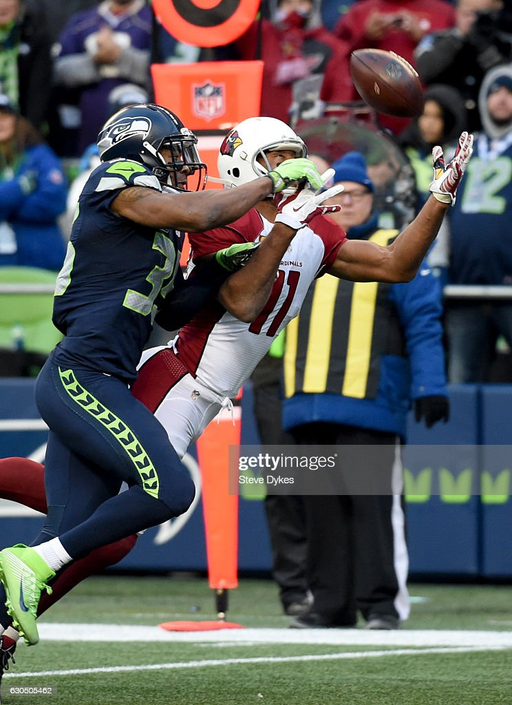 Wide receiver Larry Fitzgerald #11 of the Arizona Cardinals brings in a catch against the Seattle Seahawks at CenturyLink Field on December 24, 2016 in Seattle, Washington.
