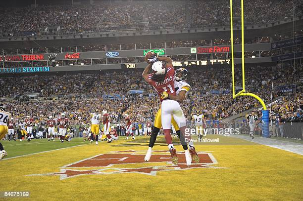 Wide receiver Larry Fitzgerald of the Arizona Cardinals catches a pass for a touchdown over cornerback Ike Taylor of the Pittsburgh Steelers during...