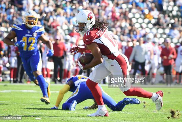 Wide receiver Larry Fitzgerald of the Arizona Cardinals catches a pass from quarterback Josh Rosen to tie Jerry Rice at 16000 receiving yards and...