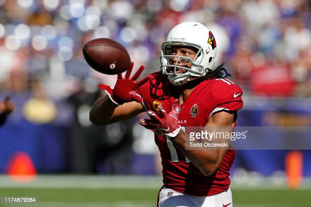 Wide Receiver Larry Fitzgerald of the Arizona Cardinals catches a pass against the Baltimore Ravens during the second half at MT Bank Stadium on...